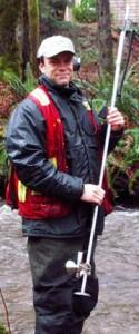 Biologist Warren Fleenor holding a flow meter.