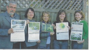 CVCS members show off a new local natural areas conservation calendar.